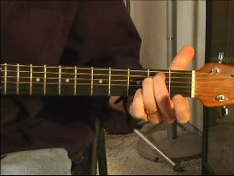How to Play Acoustic Guitar : How to Play an E-Minor Chord on the Acoustic Guitar