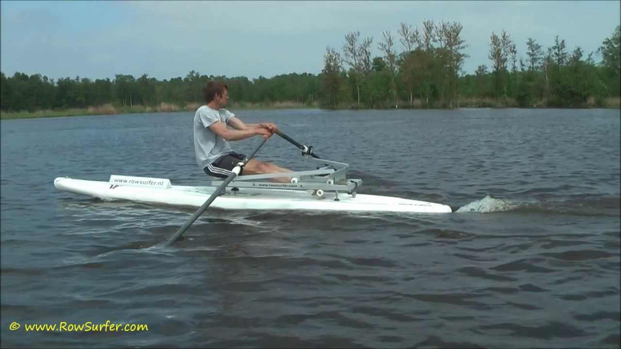 Rowing On A Stand Up Paddle Surfboard Sup With The
