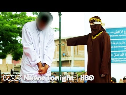 Crowds Cheer As Gay Men Are Caned in Indonesia (HBO)