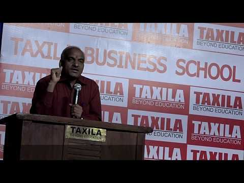 IIM Director Dr B.Metri talks toTaxila Business School PGDM students