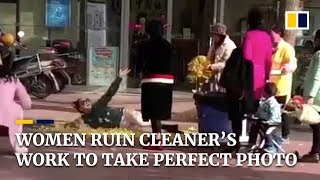 Women in China ruin cleaner's work to take perfect photo
