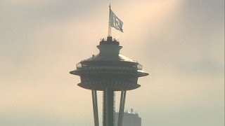 12th Man Flag Raised Atop Seattle Space Needle