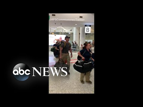 US firefighters welcomed at Australian airport with round of applause