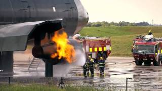 Airport fire fighter training excercise. Manchester Airport UK