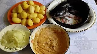 Сом, запеченный с картофелем.