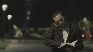 Businessman Using Smart Phone Make a Call While Standing at Park in a City Square, and Make Notes |