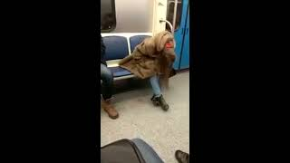 The girl-junkie under hard drugs on the russian subway. Девушка-торчок гасится в метро.