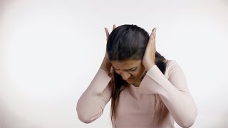 Indian woman protecting herself against domestic violence - white background