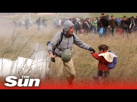 Refugees in Greece start fires and children are knocked over as crowds clash with police