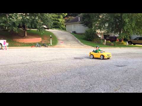 Eli Drifting his weed eater powered power wheels.