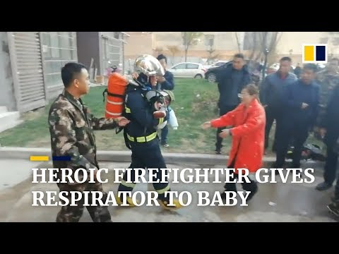 Heroic Chinese firefighter gives his respirator to baby