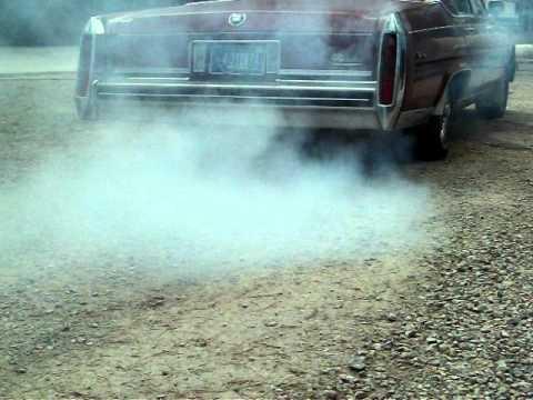 Exhaust shot seafoam smoke 1984 Cadillac Fleetwood Brougham d'Elegance 4100 V-8.