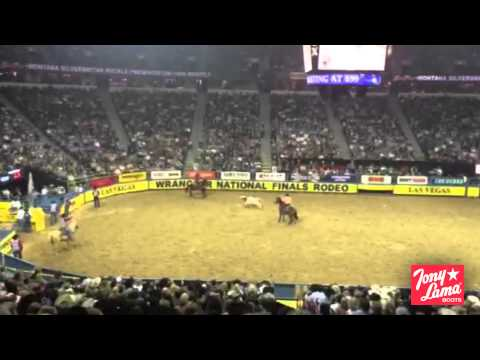 Clay O'Brien Cooper and Aaron Tsinigine Win Round 6 of the 2014 Wrangler National Finals Rodeo