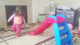 Toddler playing indoor slide while listening to Zaky Mariam Fatima Everything song