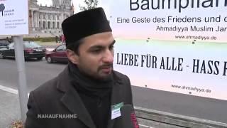 Ahmadiyya Muslims plant tree infront of Paul-Loebe Haus in Berlin, Germany