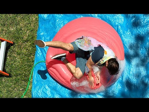 Falling onto a Giant Water Balloon at 12,500fps - The Slow Mo Guys