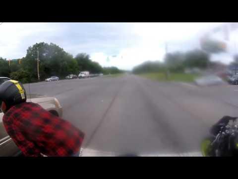 Biker smashes car window