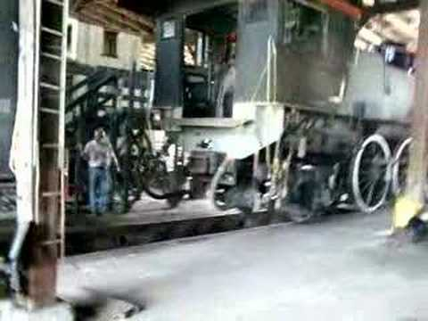 Steam engine tender in roundhouse