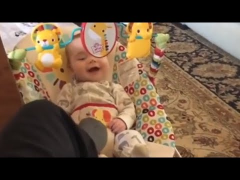 Giggling baby can't stop laughing with babysitter