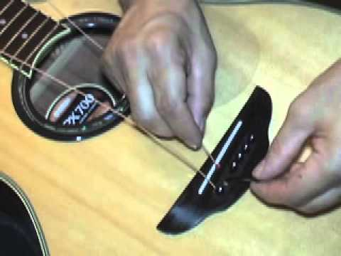 How to Restring an Acoustic Guitar and clean the rosewood fretboard