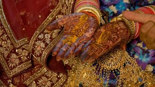 Indian Wedding - Performing wedding ritual with an Indian bride