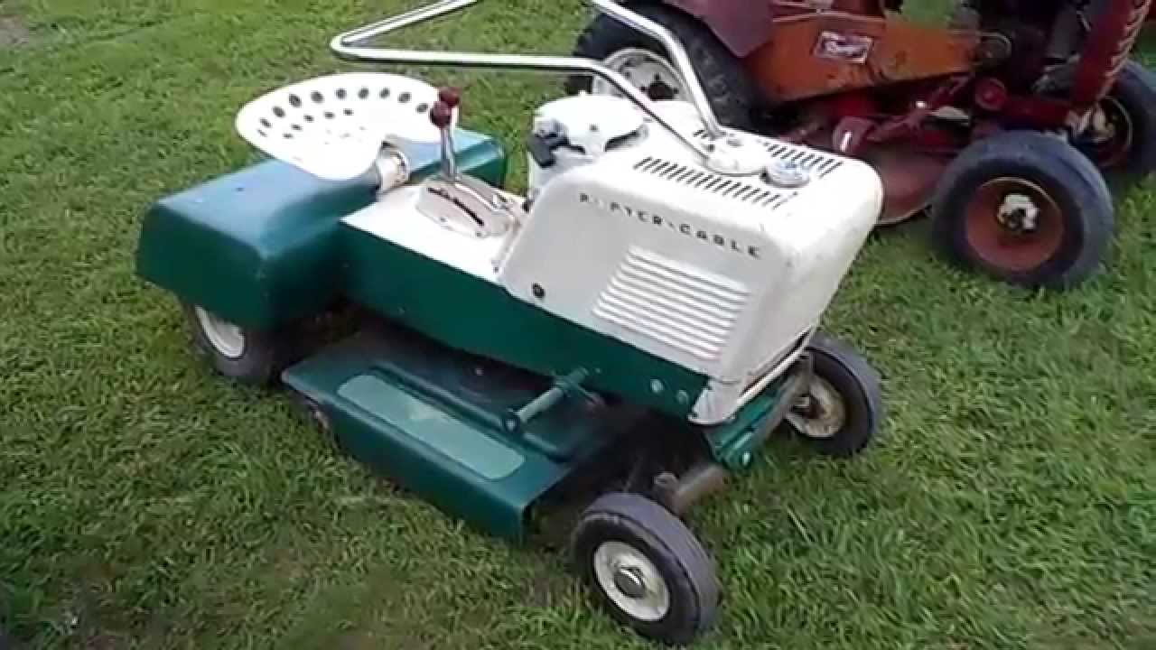 Some Lawn Mowers And A Jeep At The Tractor Show Youtube