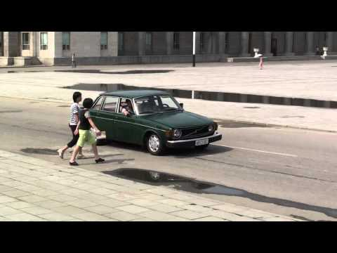 A Volvo 144 passing the Kim Il Sung square in Pyongyang