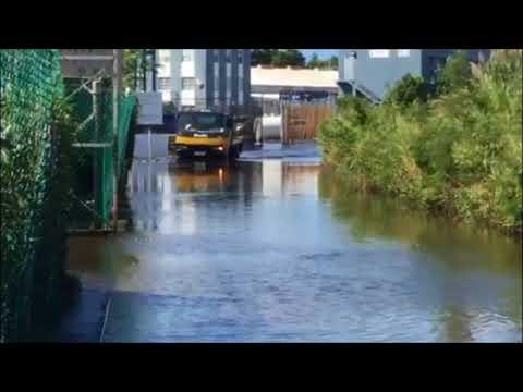 Trucks Drive Through Flooded Mills Creek, Oct 9 2017