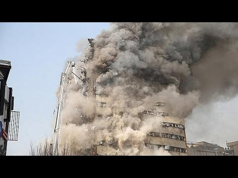 High-rise shopping mall collapses in central Tehran dozens of firefighters trapped or killed