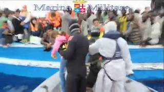 BBC News  Saving migrant boats in trouble - Italy's Navy on the open sea