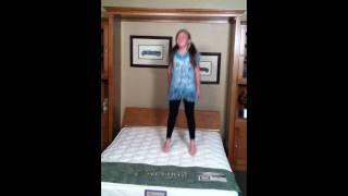 Kid Jumping On A Murphy Wall Bed