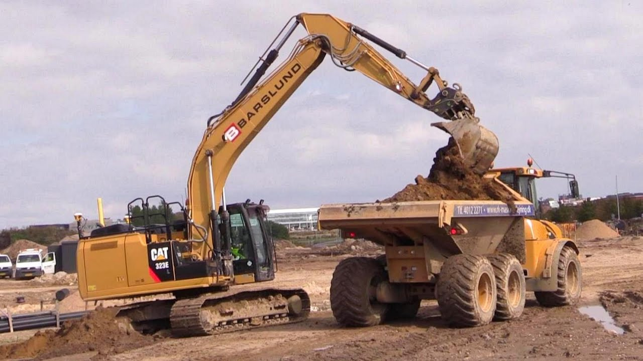Cat 323e Excavator With 3d Gps Loading Hydrema 922d Dumper