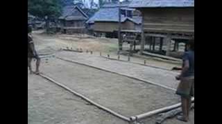 Kids playing Petanque-like game in a remote village in Northern Laos