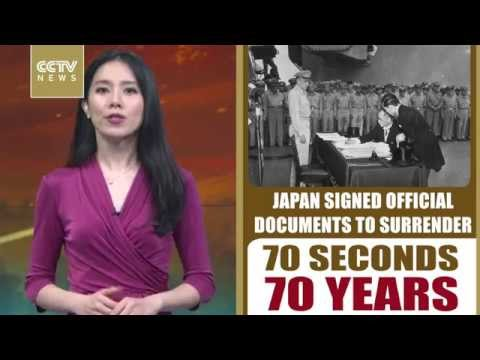 Japan signs documents to surrender in WWII in 1945