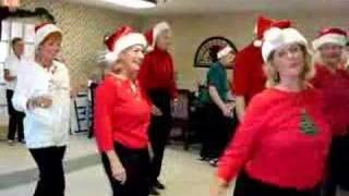 Line Dancers dance to Merry Christmas Polka