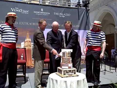 Executives From IHG + Las Vegas Sands Cut Celebratory Cake at Block Party