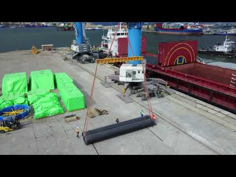 Tubes operated in direct transshipment vessel-barge, LHM 320 crane, berth 39
