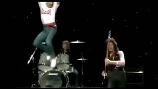 Freddie Mercury Jumping from Roger's Drum and snatches Guitar from Brian