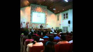 Tim Preaching in the Spanish Church - Luis Translating to English