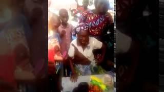 AFRICAN PRINCESS GIFTING AN AGED WOMAN