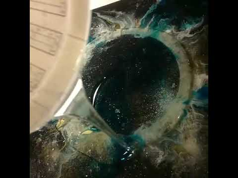 Final artresin pour over crystal infused glow in the dark inspired eclipse painting
