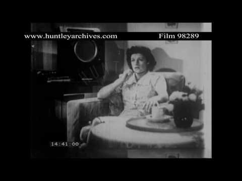 Woman listens to radio, 1940's U.K.  Archive film 98289