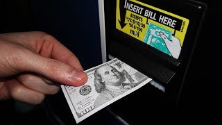 Trying to use Fake Money at the Arcade!
