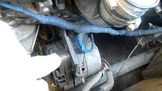 после снятия крепления генератора придется домкратить  двигатель