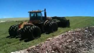 2 MT965C tractors with18' Grouser Blades pushing and packing wheatlage