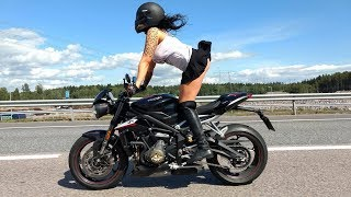 Bomber Babe rides Triumph Street Triple RS 765