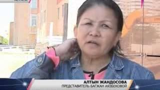 В Астане две женщины в знак протеста взобрались на башенный кран(, 2013-05-29T16:36:56.000Z)