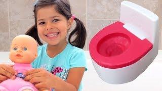 BABY POOP & BATH! Toilet training - bubble bath - soap in eyes - bottle feed - mess on floor