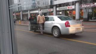 Altercation between motorist and cyclist in Toronto