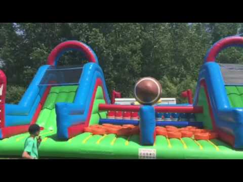 Inflatable bounce house rental Eagan MN . Football obstacle course . For more details go to www.aff